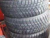 215 65 16r. 90% MICHELIN 4hat M + S texadrum anvjar