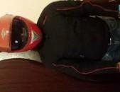 Шлем и куртка мотоциклиста